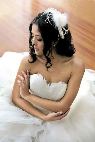 Some brides achieve the angelic look with a feathered gown and headband. Photo: KEVIN GEIL / KEVIN GEIL