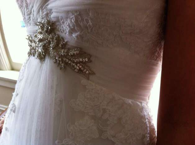 This Pronovias gown, $1,995, by Bridal Galleria of Texas, includes sparkling details above the waist.