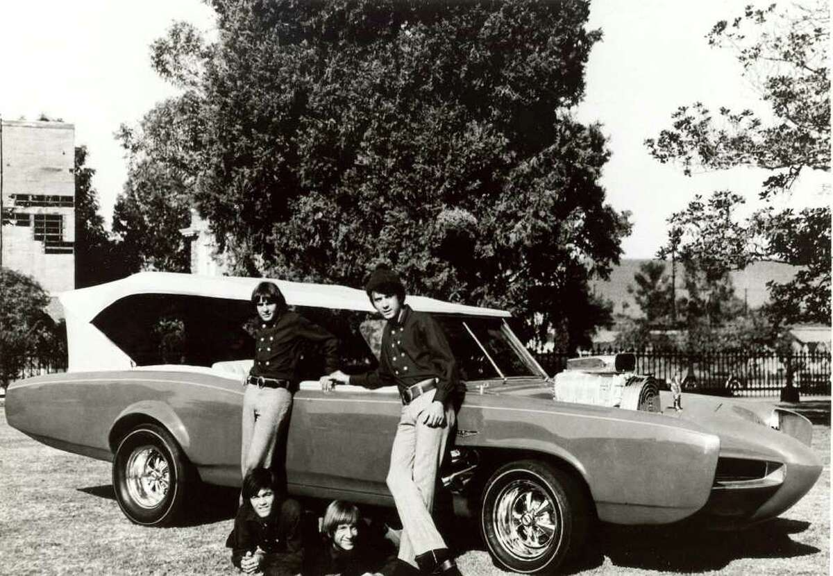 """FILE - In this 1966 file photo, cast members of the television show """"The Monkees,"""" from top left, Davy Jones, Michael Nesmith, from lower left, Micky Dolenz, and Peter Tork pose next to their customized Pontiac GTO. Jones died Wednesday Feb. 29, 2012 in Florida. He was 66. Jones rose to fame in 1965 when he joined The Monkees, a British popular rock group formed for a television show. Jones sang lead vocals on songs like """"I Wanna Be Free"""" and """"Daydream Believer."""""""
