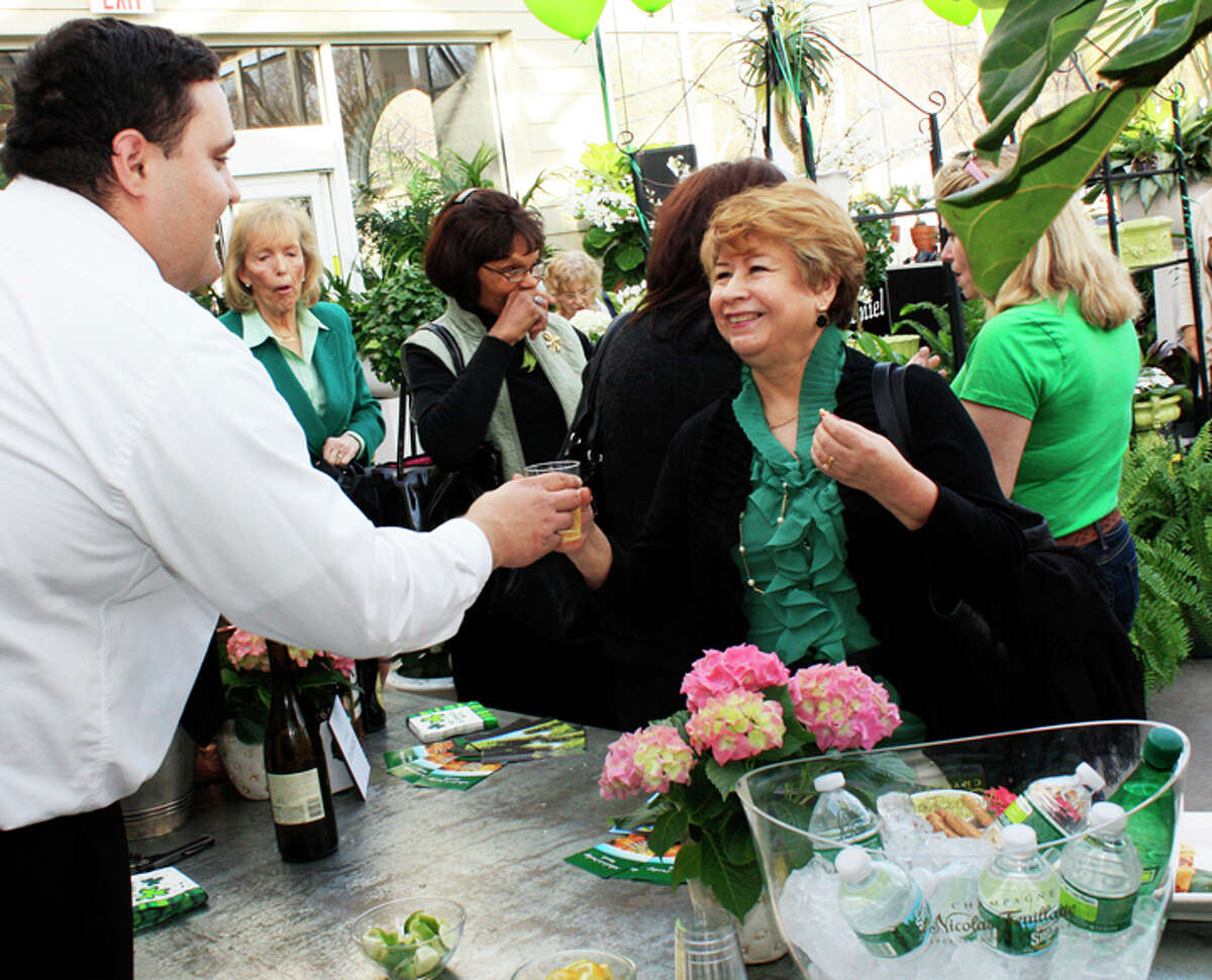 An attendee receives a drink from a waiter at last year's event.