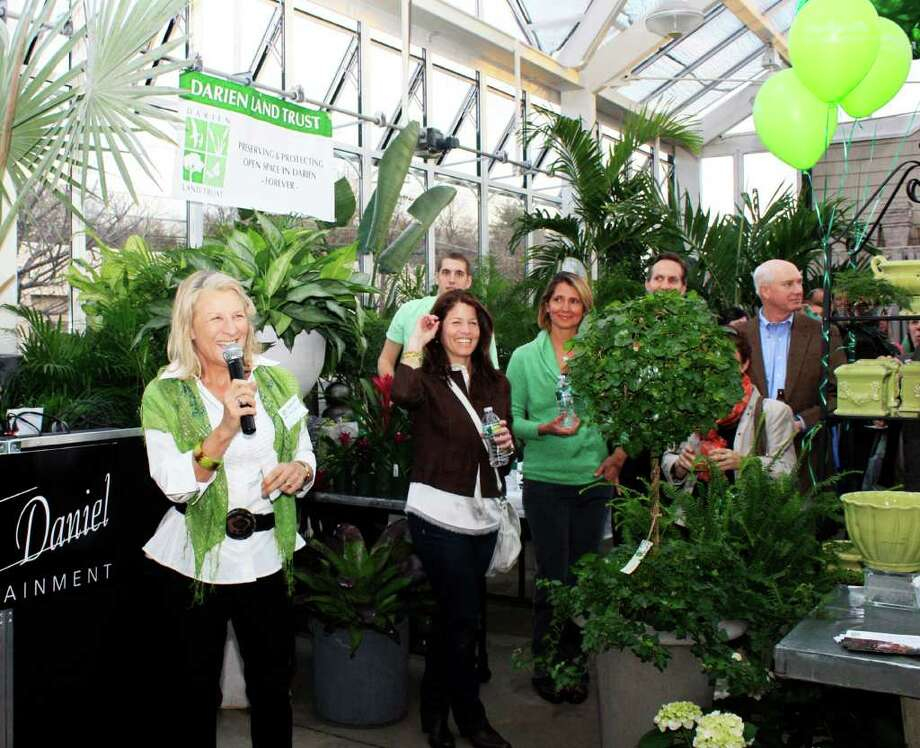 Shirley Nichols of the Darien Land Trust addresses the crowd at last year's first annual St. Patricks Day event at Nielsen's Florist. Photo: Contributed Photo