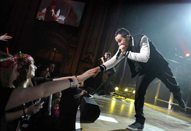 Carlos Pena, Jr. of Big Time Rush touches the hand of a fan during a performance at the Palace Theatre Tuesday, Feb. 28, 2012 in Albany, N.Y.  (Lori Van Buren / Times Union) Photo: Lori Van Buren