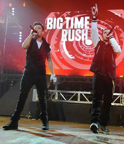 From left, Logan Henderson and Carlos Pena, Jr. of Big Time Rush perform to a sold out audience at the Palace Theatre Tuesday, Feb. 28, 2012 in Albany, N.Y.  (Lori Van Buren / Times Union) Photo: Lori Van Buren