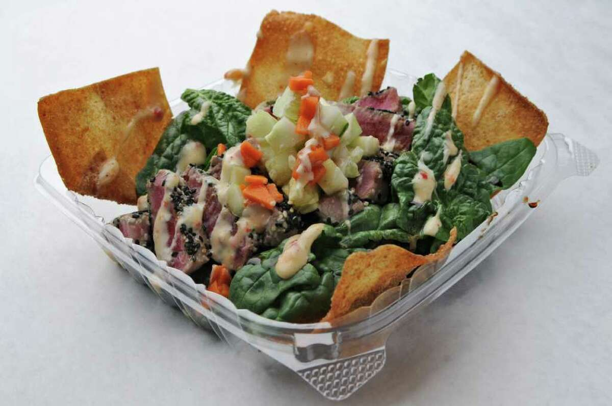 The Tuna Nacho Salad is sesame crusted Asian tuna, crispy wontons, spinach and a trio of Asian sauces, at Sangwych on Tuesday Dec. 6, 2011 in Saratoga Springs, NY. (Philip Kamrass / Times Union )
