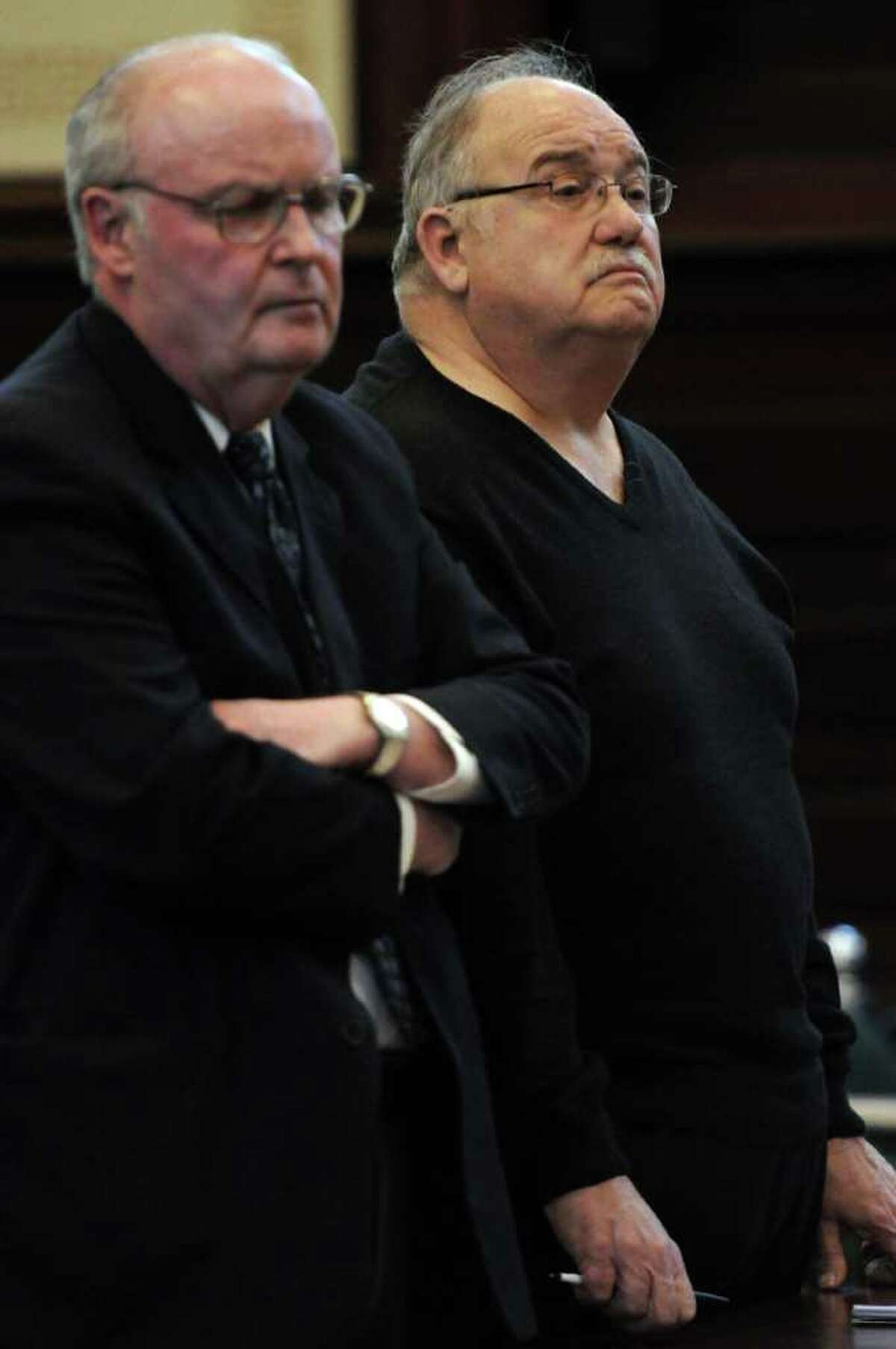 Anthony J. Renna, right, pleads guilty to forgery for his role in a ballot fraud case in Rensselaer County Court on Tuesday Dec. 20, 2011 in Troy, N.Y. (Philip Kamrass / Times Union archive)