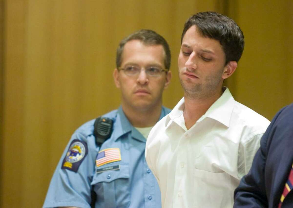 Spero Moschos, 28, and appears with attorney Stephan Seeger as he was arraigned in Superior Court in Stamford for two bank robberies in Stamford, Conn. on Thursday, August 27, 2009. Moschos is also wanted in New York for additional robberies.