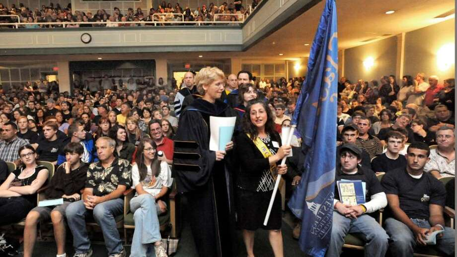 New students and parents watch the procession during the Opening Ceremony in  Ives Auditorium on the WCSU downtown campus on Aug. 28,2009. Seated center, left of procession is Kristi Marie Parille of New Fairfield and right of the procession is Nicholas Dunn of Danbury, both members of the class of 2013. Photo: Michael Duffy / The News-Times