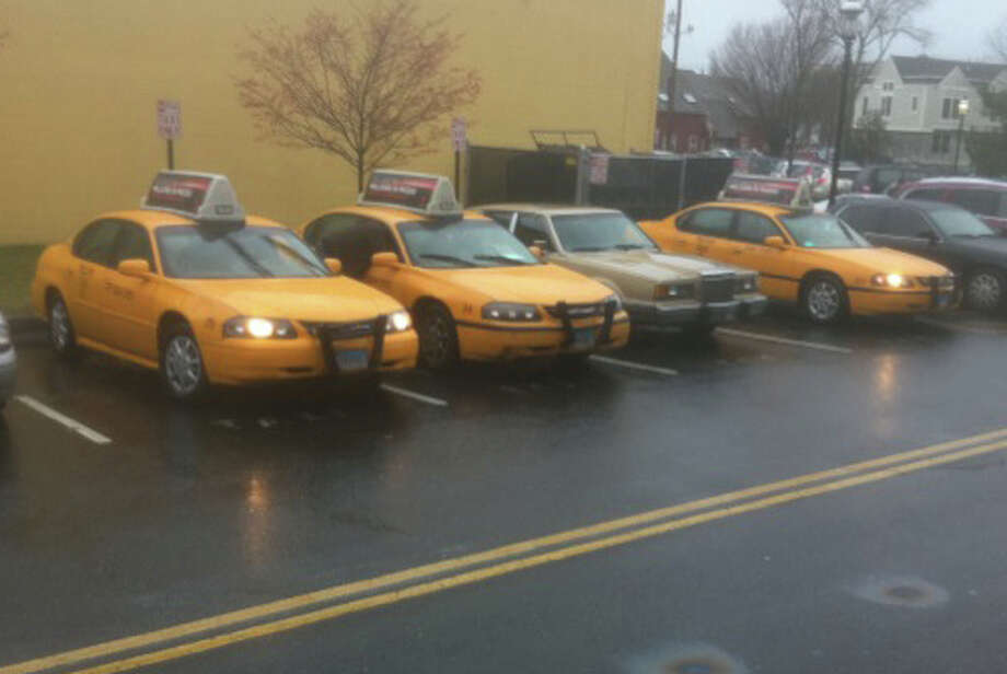 Yellow Cab of Bridgeport, which on Wednesday afternoon took over ownership of the troubled Fairfield Cab Co., dispatched a fleet of its vehicles for the evening rush at the Fairfield Railroad Station. Photo: John Schwing / Fairfield Citizen contributed