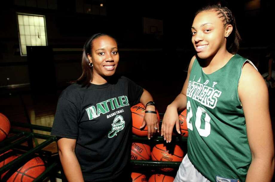 When assistant Selena Winbush (left) came to Reagan, she brought in Sabrina Berry, her sister and a talented forward. Photo: HELEN L. MONTOYA, San Antonio Express-News / ©2012 San Antonio Express-News