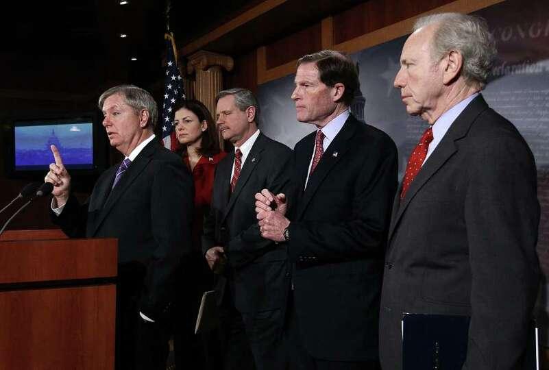 (L-R) U.S. Sen. Lindsey Graham (R-SC), U.S. Sen. Kelly Ayotte (R-NH), U.S. Sen. John Hoeven (R-N.D.)