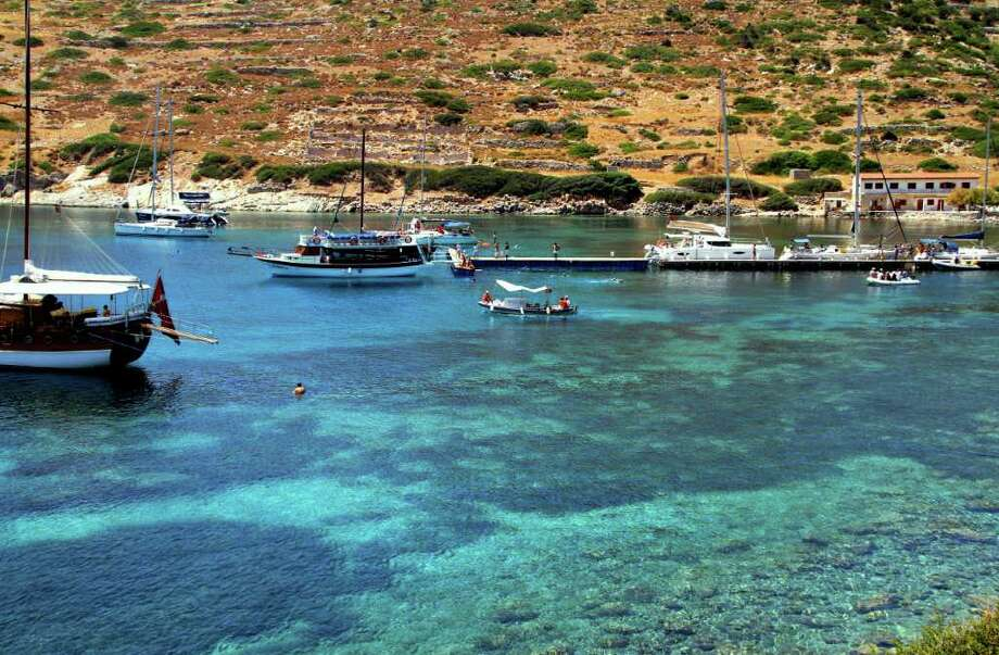 This July 2011 photo shows boaters and swimmers along the coastline of the Datca peninsula, near the ruins of Knidos, a seventh-century B.C. Greek town, Turkey. Datca is  just one stop on a driving tour from Istanbul down the Aegean coast.   (AP Photo/Giovanna Dell'Orto) Photo: Giovanna Dell'Orto / ap