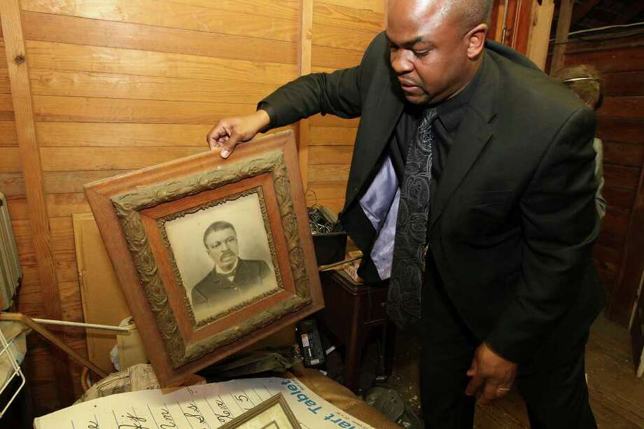 Taj Matthews, Claude and ZerNona Blacks' grandson, examines a portrait of his great-grandfather William Black, while looking over his grandfather's collection of material on Wednesday, Feb. 29, 2012. Matthews is donating the collection to Trinity University. It will include his papers and recordings, among other items. Photo: Jerry Lara, San Antonio Express-News / © San Antonio Express-News