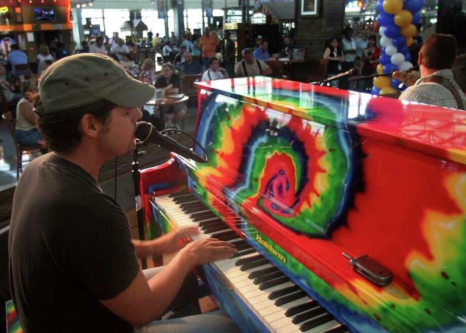 Rick Trevino entertains travelers at Austin-Bergstrom International Airport. Photo: Sandy Stevens / Austin-Bergstrom International A