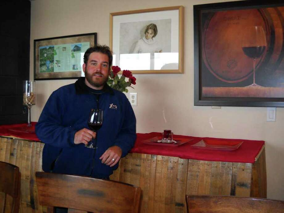 Winemaker Evan McKibben shows off the tasting room at Red Caboose Winery in Meridian.