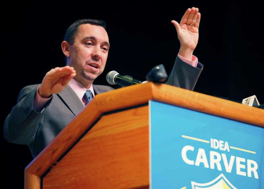 Tom Torkelson, IDEA Public Schools' CEO and co-founder, got a standing ovation from city and business leaders, but not Carver parents. Photo: William Luther, San Antonio Express-News / © 2012 WILLIAM LUTHER