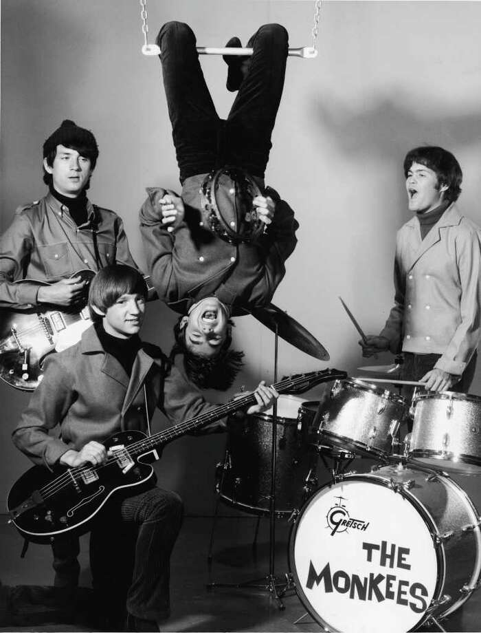 The Monkees, from left, Michael Nesmith (back), Peter Tork (fore), Davy Jones (hanging upside down), and Mickey Dolenz. Photo: NBC Television, Getty Images / Hulton Archive