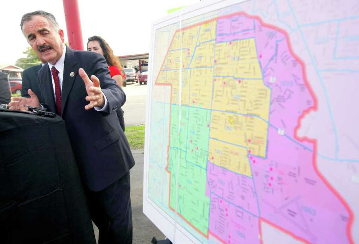 Former U.S. Rep. Ciro Rodriguez speaks at Formosa Boulevard and Pleasanton Road as he talks about the interim congressional maps that divide Harlandale ISD into three areas.