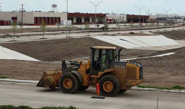 Road construction at Port San Antonio opened up 150 acres to development for companies needing access to an airfield. Photo taken on Tuesday, Feb. 28, 2012. Photo: Kin Man Hui, San Antonio Express-News / San Antonio Express-News