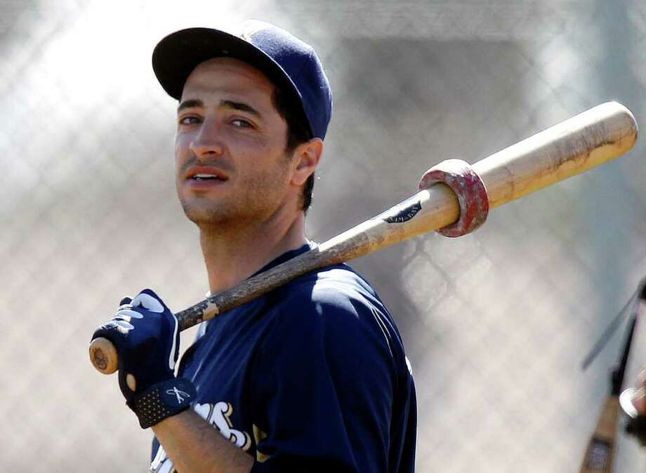 In this Feb. 25, 2012 file photo, Milwaukee Brewers outfielder Ryan Braun waits for his turn to take batting practice at baseball spring training in Phoenix. Braun's 50-game suspension had been overturned the week before. Photo: AP