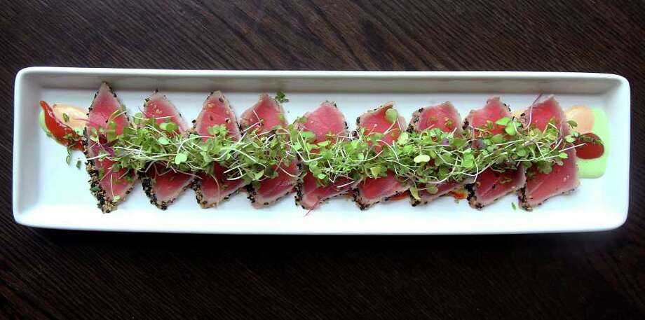 TASTE  Seared tuna at Piranha Killer Sushi on February 28, 2012 Tom Reel/ San Antonio Express-News Photo: TOM REEL, San Antonio Express-News / San Antonio Express-News