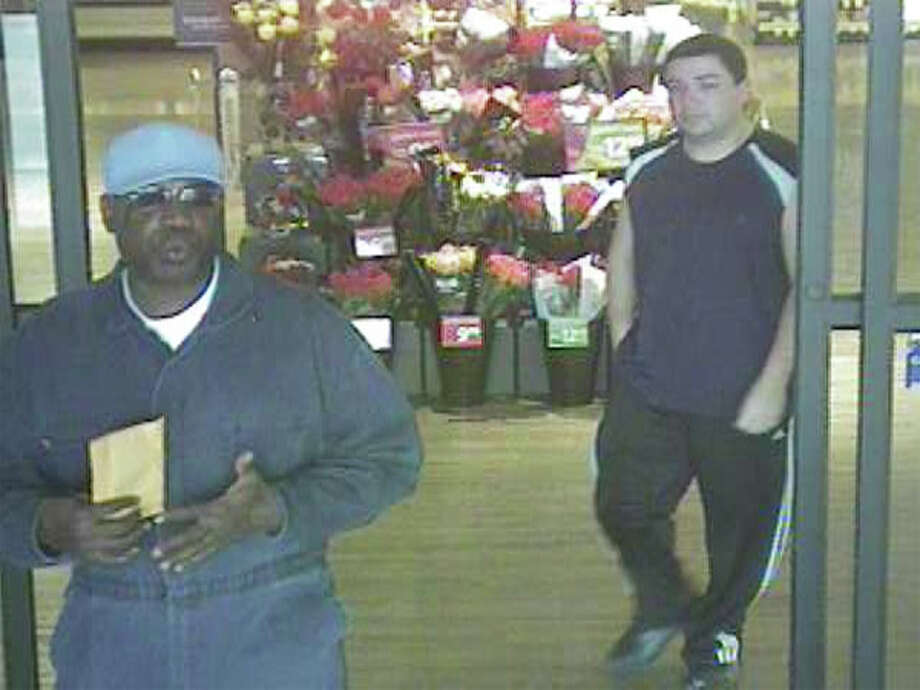 Brazoria County Sheriff's Office is searching for these two men in connection with the Wednesday robbery of the Associated Credit Union of Texas inside a Randalls store in the 10000 block of Broadway in Pearland. Photo: Brazoria County Sheriff's Office