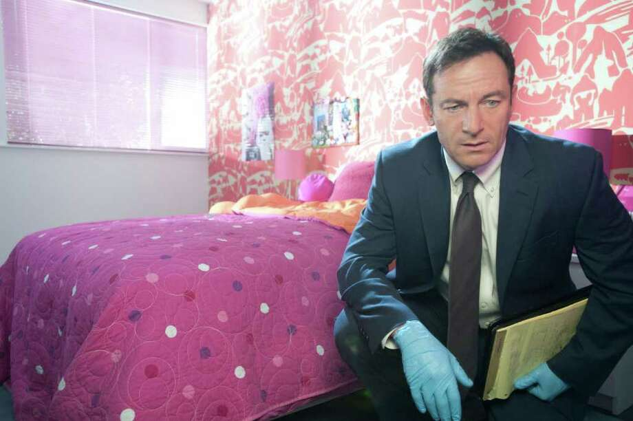 L.A. police detective Michael Britten (Jason Isaacs) deals with confused realities in the new drama 'Awake.' Photo: Lewis Jacobs / © NBCUniversal, Inc.