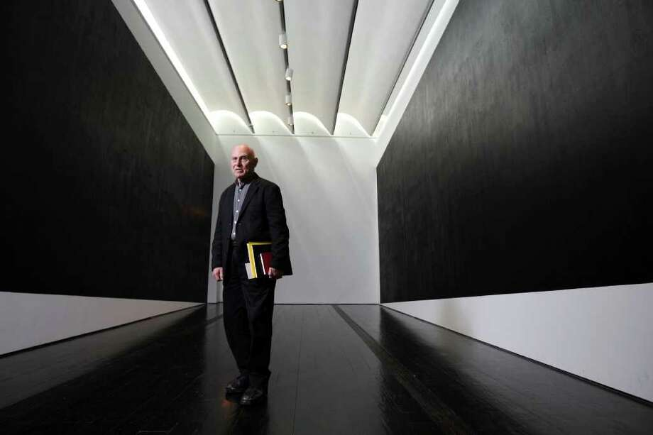 """Richard Serra stands within the site-specific installation he created at the Menil Collection for Richard Serra Drawing: A Retrospective. The two large """"drawings,"""" hung so that they look as if they are tilting up, play with the viewers' perspective of the room. Photo: Nick De La Torre / © 2012  Houston Chronicle"""