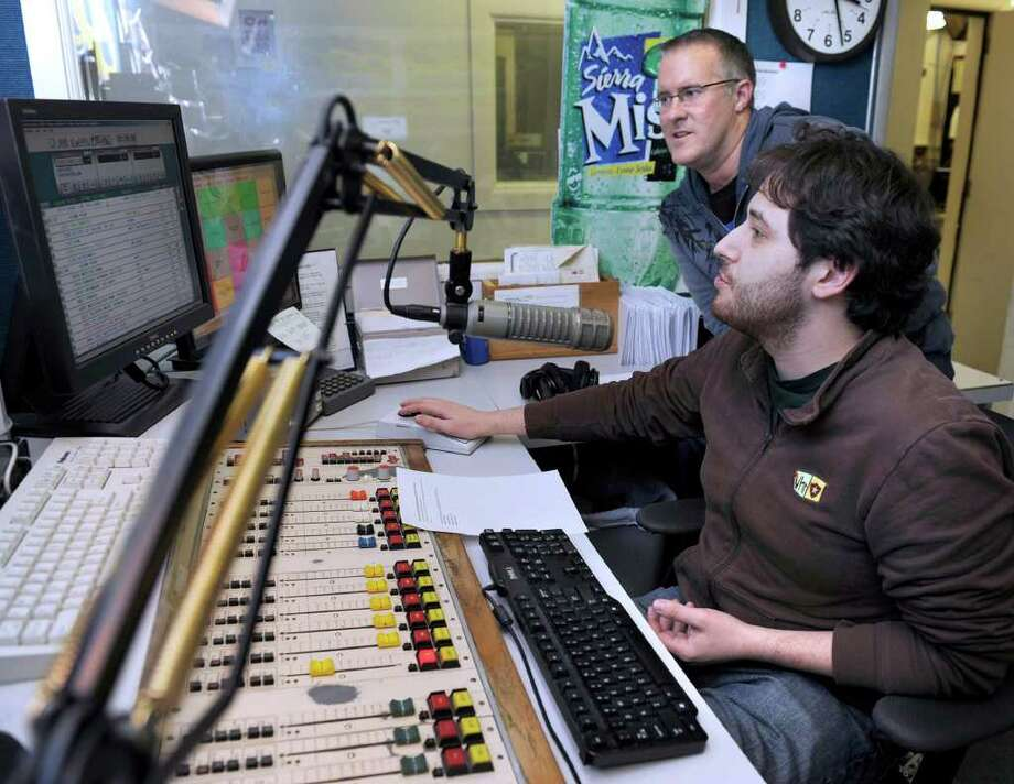Nate Mumford, right, whose studio name is simply Nate, and Rich Minor, program director and a morning show host, work in the 98Q FM main studio at the radio station Wednesday afternoon. Photo taken Wednesday, Feb. 29, 2012. Photo: Carol Kaliff / The News-Times