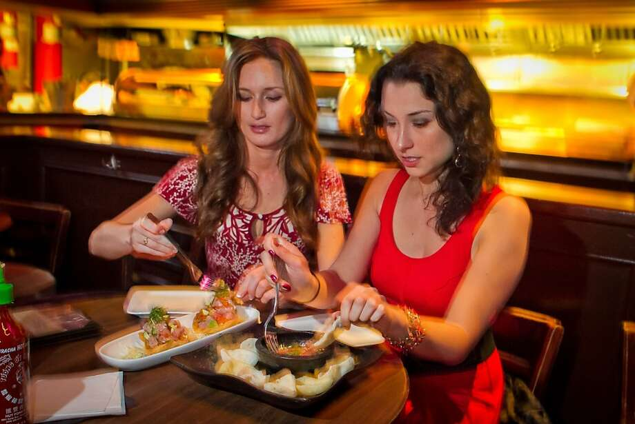 Camila Perez and Jacquie Siegel, right, enjoy food at Chubby Noodles within Amante Bar in San Francisco, Calif., on Saturday, February 25th, 2012. Photo: John Storey