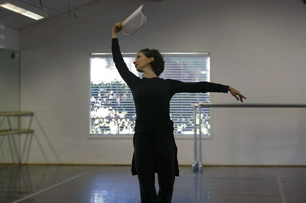 Joanna Berman dances with notes in head as an example for the other ballet dances. Joanna Berman, formerSan Francisco Ballet Principal Dancer, is staging a duet from Christopher Wheeldon's work Mercurial Manoeuvres on Diablo Ballet.