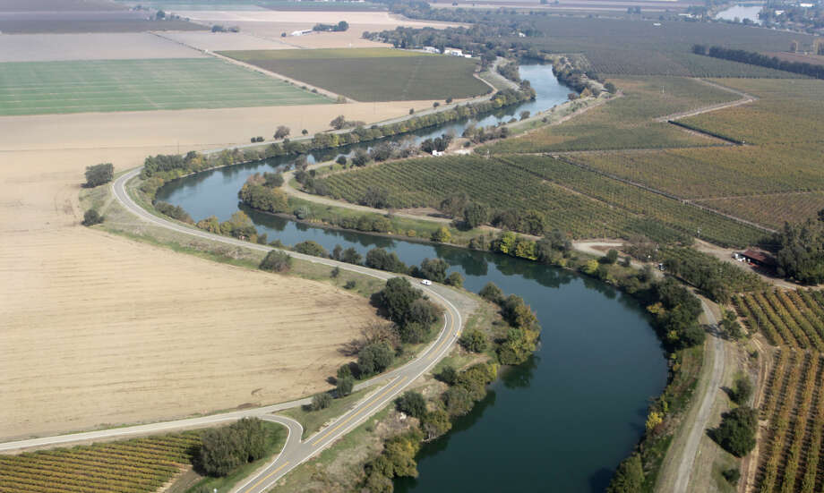 Sutter Slough winds through farmland in the Sacramento-San Joaquin River Delta on Wednesday, Nov. 9, 2011. If built, the Peripheral Canal would divert fresh water to the south and could have a significant impact on the future of the delta, its wildlife and local farming. Photo: Paul Chinn / The Chronicle / ONLINE_YES