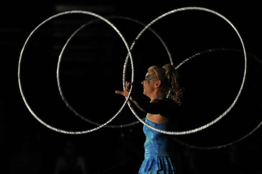 Hula Hoop champion Elena Arestov performs during the Yankee Doodle Circus performance at Schenectady High School, to benefit the school's chapter of Students Against Destructive Decisions on Wednesday evening Feb. 29, 2012 in Schenectady, N.Y.  (Philip Kamrass / Times Union ) Photo: Philip Kamrass / 00016599A