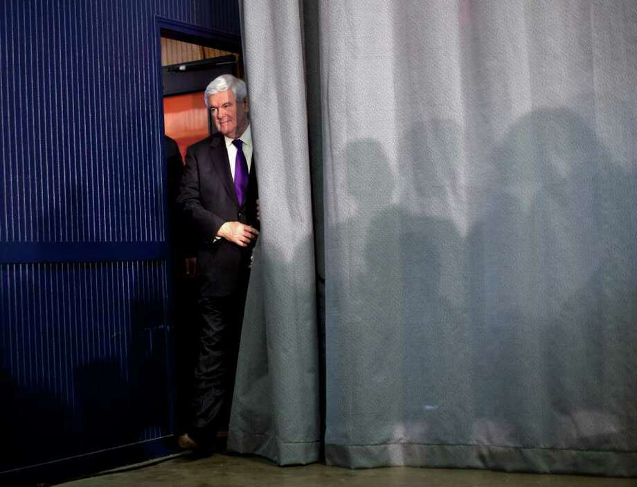 Republican presidential candidate, former House Speaker Newt Gingrich arrives for a campaign rally at Peachtree Academy, Wednesday, Feb. 29, 2012, in Covington, Ga.  (AP Photo/Evan Vucci) Photo: Evan Vucci, Associated Press / AP