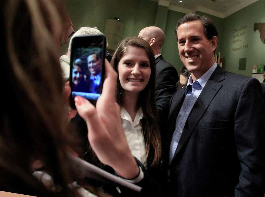 Republican presidential candidate, former Pennsylvania Sen. Rick Santorum poses for a photo after speaking at Temple Baptist Church, Wednesday, Feb. 29, 2012, in Powell, Tenn. (AP Photo/Mark Humphrey) Photo: Mark Humphrey, Associated Press / AP