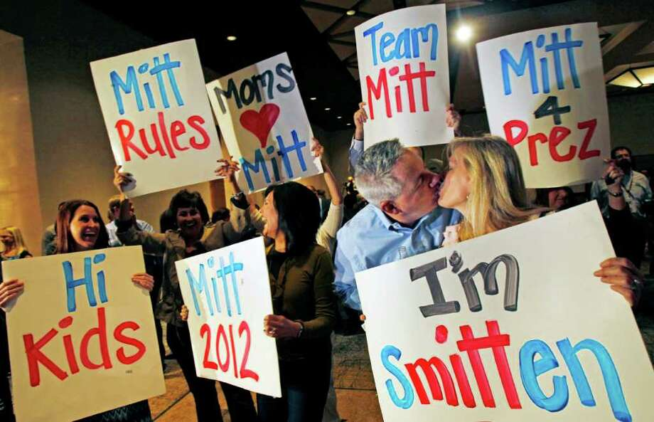 Bob Hauter, and wife Lynn Haueter, at right, celebrate as election results are broadcast, during a gathering of supporters for former Massachusetts Governor, presidential candidate Mitt Romney, Tuesday, Feb. 28, 2012 at the Hyatt Regency in Phoenix. Romney won Arizona's primary Tuesday, with exit polls showing he earned support from a broad cross-section of Republicans. (AP Photo/The Arizona Republic, David Kadlubowski)  MARICOPA COUNTY OUT; MAGS OUT; Photo: David Kadlubowski, Associated Press / The Arizona Republic