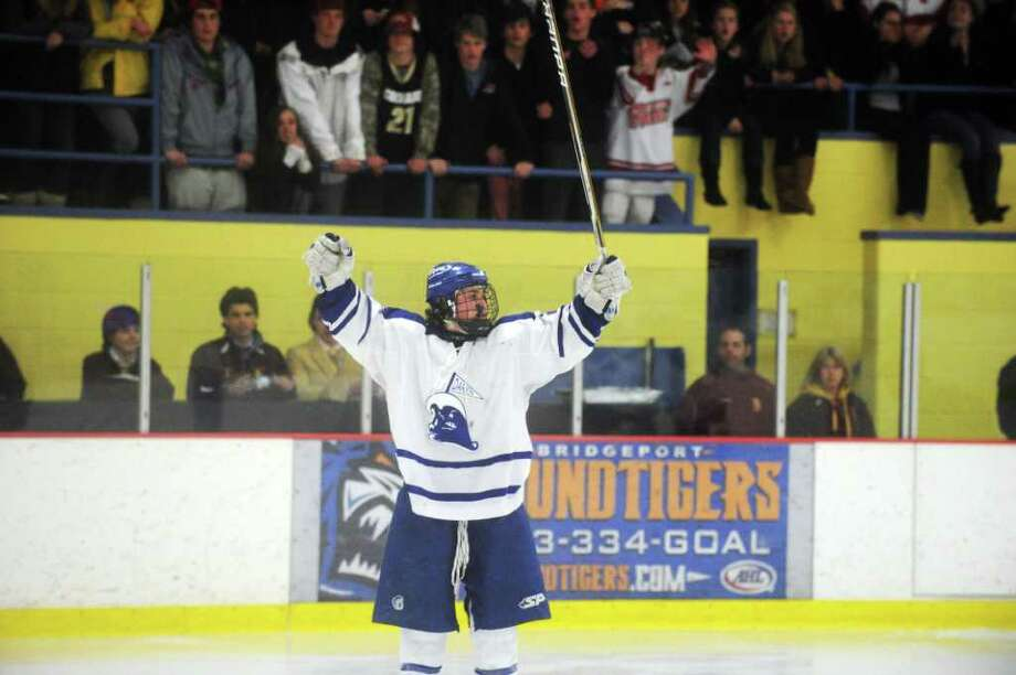 Darien's Brendan Hathaway with the hat trick as Darien and New Canaan High Schools face off in the FCIAC boys hockey semifinals at Terry Conners Rink in Stamford, Conn., February 29, 2012. Darien won the game 5-2. Photo: Keelin Daly / Stamford Advocate