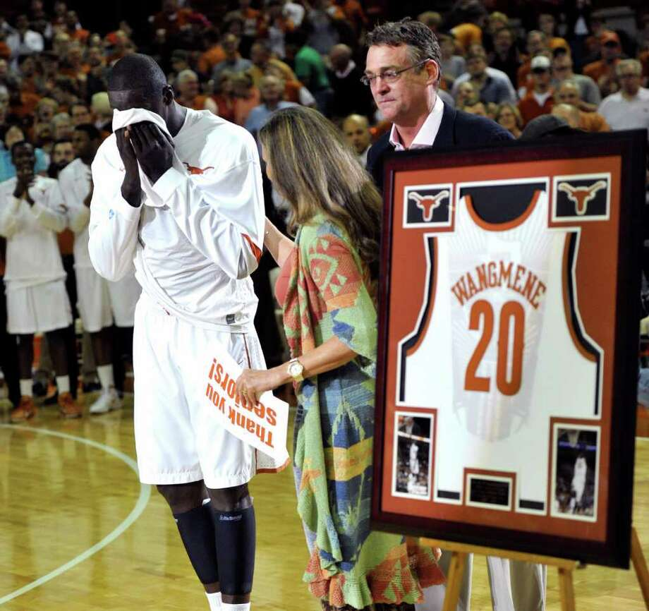 Texas forward Alexis Wangmene, left, wipes his eyes during a senior-night presentation before his final home game, against Oklahoma on Wednesday, Feb. 29, 2012, in Austin, Texas. Photo: AP