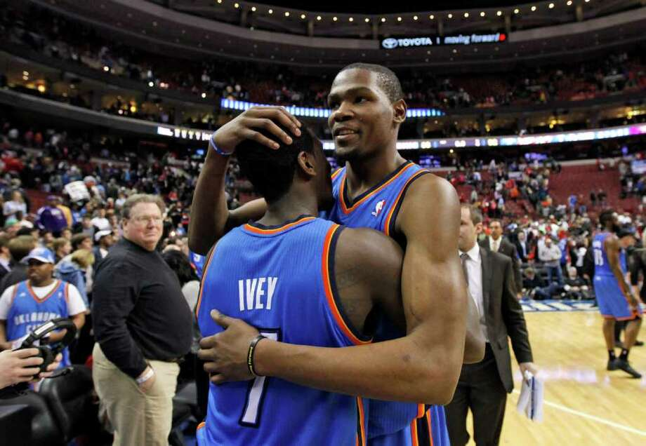 Oklahoma City's Kevin Durant and teammate Royal Ivey savor their win over the 76ers. Photo: AP