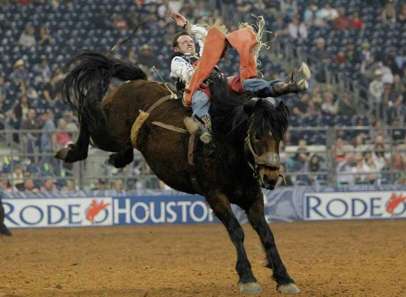 Matt Bright competes in Bareback Riding during the Rodeo Houston BP Super Series I Round 2 at Relian