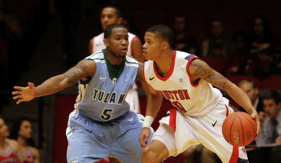 The University of Houston's Joseph Young right, and Tulane University's Jordan Callahan during the first half of men's college basketball game action at the University of Houston's Hofheinz Pavilion Wednesday, Feb. 29, 2012, in Houston. Photo: James Nielsen, Chronicle / © 2011 Houston Chronicle