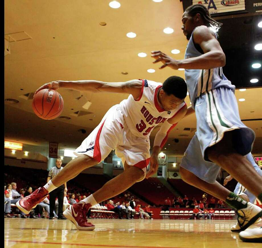 The University of Houston's TaShawn Thomas left, and Tulane University's Josh Davis during the second half of men's college basketball game action at the University of Houston's Hofheinz Pavilion Wednesday, Feb. 29, 2012, in Houston. Photo: James Nielsen, Chronicle / © 2011 Houston Chronicle