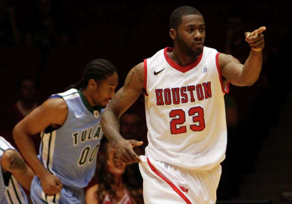 The University of Houston's Jonathon Simmons points his finger after scoring a shot against Tulane University during the first half of men's college basketball game action at the University of Houston's Hofheinz Pavilion Wednesday, Feb. 29, 2012, in Houston.