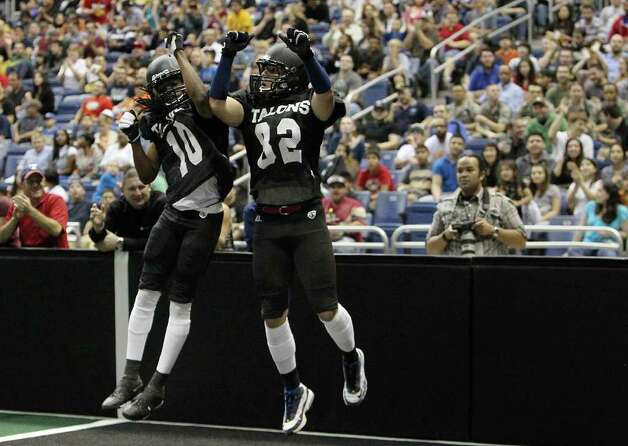 San Antonio Talons' Robert Quiroga (82) gets congratulated by teammate Brent Holmes (10) after scoring a touchdown against the San Jose SaberCats in an exhibition game for the city's newest Arena Football League team at the Alamodome on Wednesday, Feb. 29, 2012. The Talons first game will be on March 10. Photo: Kin Man Hui, Kin Man Hui/San Antonio Express-News / San Antonio Express-News