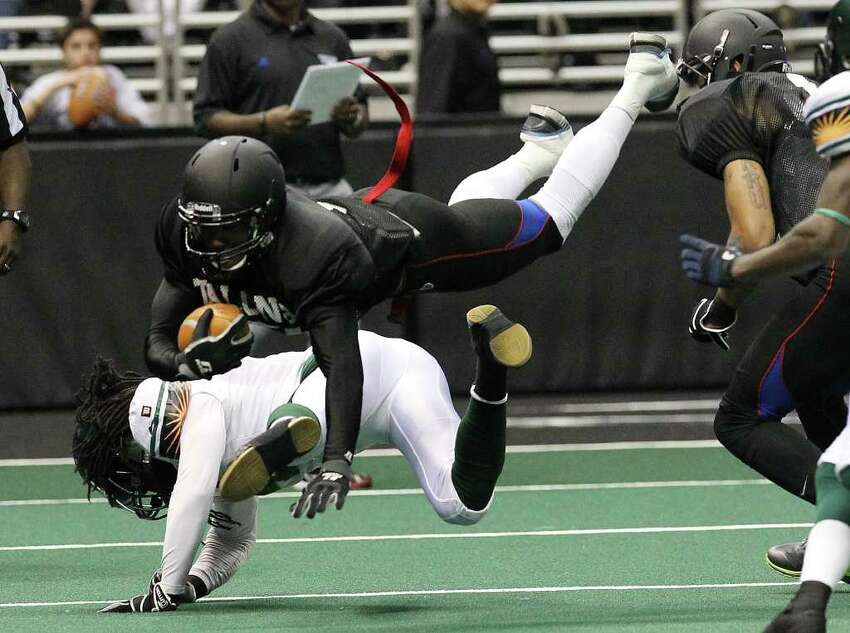 San Antonio Talons' Jason Willis dives for yardage against San Jose SaberCats in an exhibition game for the city's newest Arena Football League team at the Alamodome on Wednesday, Feb. 29, 2012. The Talons first game will be on March 10.