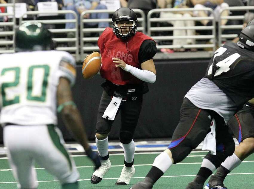 San Antonio Talons quarterback Aaron Garcia (08) drops back for a pass against San Jose SaberCats in an exhibition game for the city's newest Arena Football League team at the Alamodome on Wednesday, Feb. 29, 2012. The Talons first game will be on March 10.