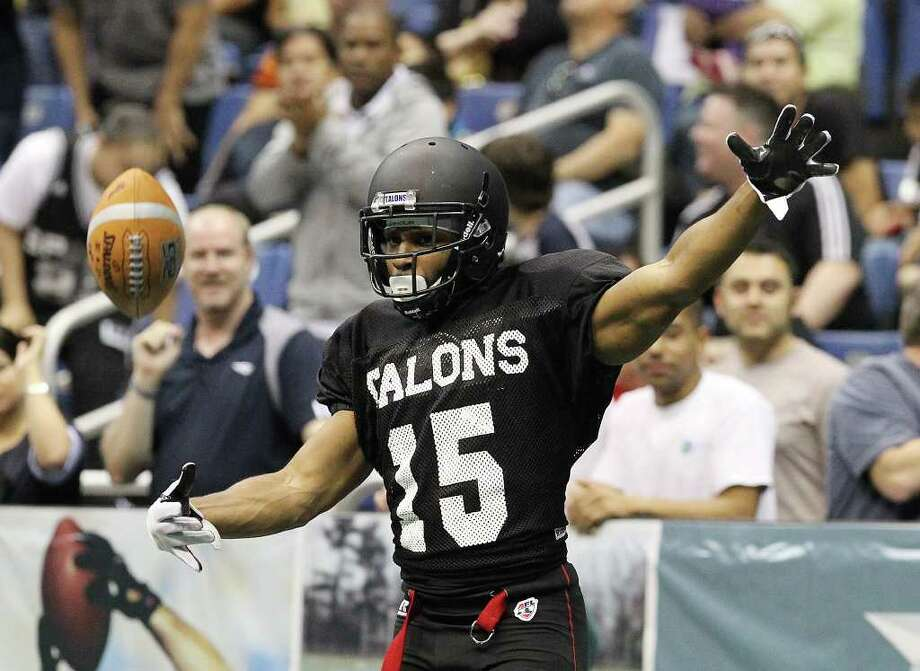 San Antonio Talons' Jomo Wilson (15) flips the ball to a referee after getting a first down against San Jose SaberCats in an exhibition game for the city's newest Arena Football League team at the Alamodome on Wednesday, Feb. 29, 2012. The Talons first game will be on March 10. Photo: Kin Man Hui, Kin Man Hui/San Antonio Express-News / San Antonio Express-News