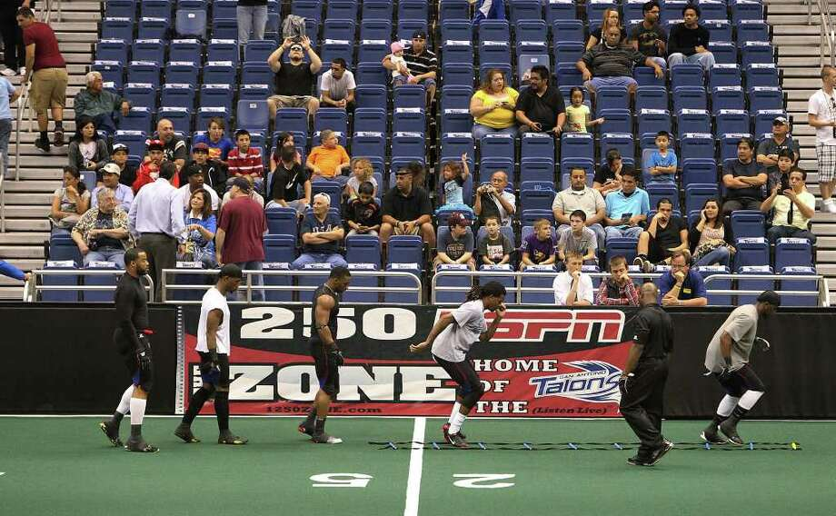 Spectators fill the seats in the Alamodome to watch the San Antonio Talons play against the San Jose SaberCats in an exhibition game for the city's newest Arena Football League team on Wednesday, Feb. 29, 2012. The Talons first game will be on March 10. Photo: Kin Man Hui, Kin Man Hui/San Antonio Express-News / San Antonio Express-News