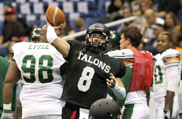 San Antonio Talons quarteback Aaron Garcia (08) throws during practice before an exhibition game against the San Jose SaberCats for the city's newest Arena Football League team at the Alamodome on Wednesday, Feb. 29, 2012. The Talons first game will be on March 10. Photo: Kin Man Hui, Kin Man Hui/San Antonio Express-News / San Antonio Express-News