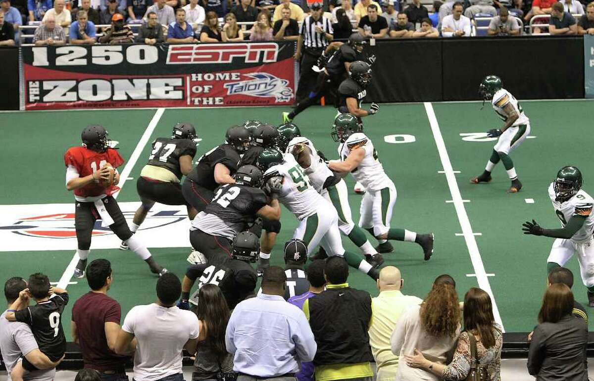 Spectators get a pretty close look at the action during the San Antonio Talons exhibition game against the San Jose SaberCats at the Alamodome on Wednesday, Feb. 29, 2012. The Talons first game will be on March 10.