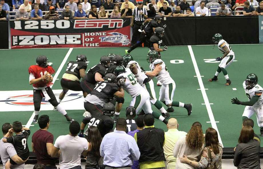 Spectators get a pretty close look at the action during the San Antonio Talons exhibition game against the San Jose SaberCats at the Alamodome on Wednesday, Feb. 29, 2012. The Talons first game will be on March 10. Photo: Kin Man Hui, Kin Man Hui/San Antonio Express-News / San Antonio Express-News